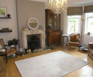 photo of beige brown white with bay window fireplace