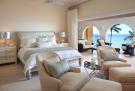 Master bedroom large stone floor balcony doors sliding Saint Peter's Bay