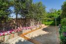 Childrens area swings Villa Cassedda Porto Cervo Sardinia