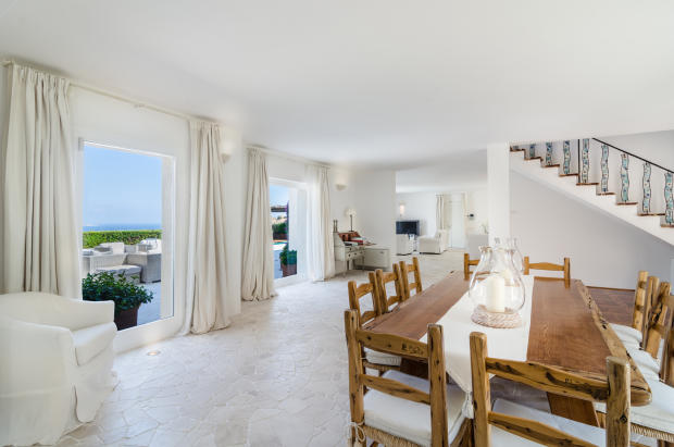 Dining room open plan stone floor french doors Villa Cassedda Porto Cervo Sardinia