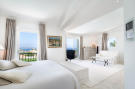 Bedroom master stone floor balcony doors Villa Cassedda Porto Cervo Sardinia