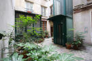 Courtyard entrance lift elavator stone Rue Frederic Sauton Paris