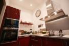 Modern kitchen red marble work top Rue Frederic Sauton Paris