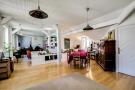 Open plan dining and living room wood floor Postel-Vinay Paris