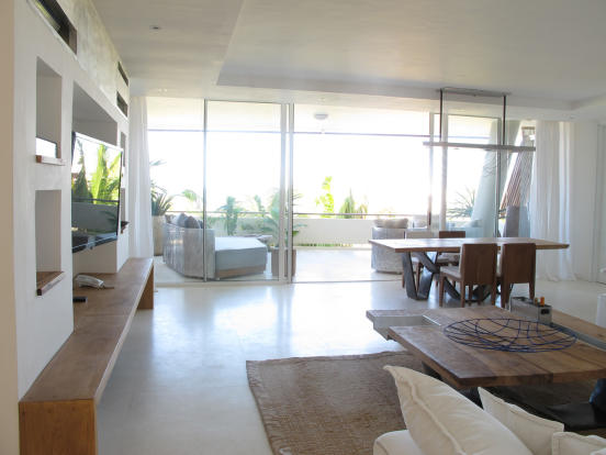 Living room dining open plan sliding doors balcony stone floor Billionaire Resort Kenya