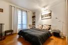 Master bedroom wood floor large window Rue Jean Mermoz Paris