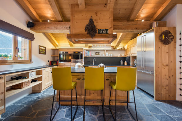 Modern kitchen and breakfast bar at Chalet Vermont in Verbier