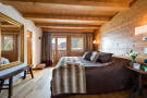 Master bedroom with balcony and en suite bathroom at Chalet Vermont in Verbier