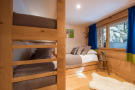 Kid's bedroom with bunk beds at Chalet Vermont in Verbier