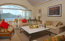 Large sitting room with terrace and views in apartment at The Landings in St Lucia