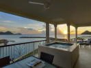 Ocean view terrace with Jacuzzi at sunset at The Landings in St Lucia