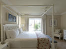 Master bedroom with four poster bed in a Marina Residence at The Landings in St Lucia
