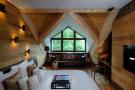 Bedroom wood floor desk Andermatt Chedi Residences