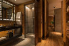 Bathroom shower stone wood floor Andermatt Chedi Residences