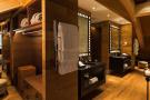 Changing room twin sink wood floor Andermatt Chedi Residences