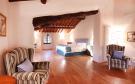 Bedroom master wood floor exposed beams Tenuta Cipressino Tuscany