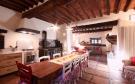 Kitchen tiled floor exposed beams large stove aga Tenuta Cipressino Tuscany