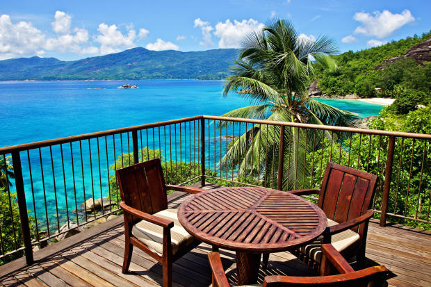 Outdoor dining area ocean sea view Four Seasons Seychelles