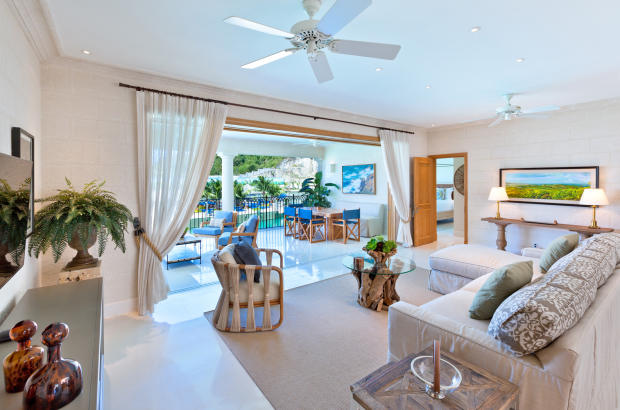 Covered balcony stone floor sliding doors living room Port Ferdinand Barbados