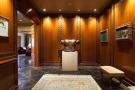 Hallway marble wood veneer The Penthouse Av de Pau Casals Barcelona