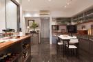 Kitchen diner stone floor The Penthouse Av de Pau Casals Barcelona