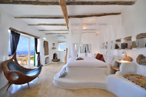 Bedroom master exposed beams marble floor french doors Lia Mykonos