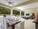 Covered terrace outdoor dining area swimming pool Sand Box at Sandy Lane Barbados