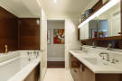 Bathroom twin sink bath tub tiled wood Riverside Boulevard New York