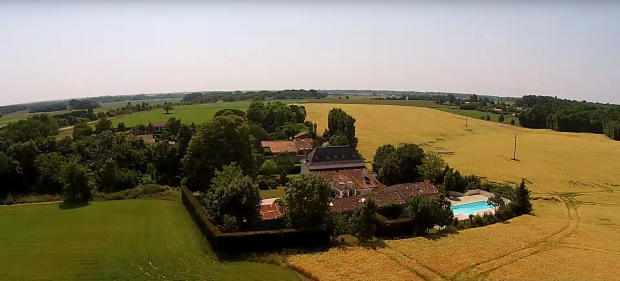 Aerial property fields surrounding swimming pool Les Jaudons Saint Porchaire