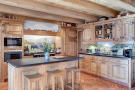 Kitchen breakfast bar tiled exposed beams country Chalet Feuille d'Erable Verbier
