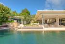 Infinity edge swimming pool rear facade Villa Vista Samujana Thailand