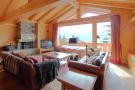 Living room wood floor balcony doors fireplace Gai Torrent Penthouse Verbier