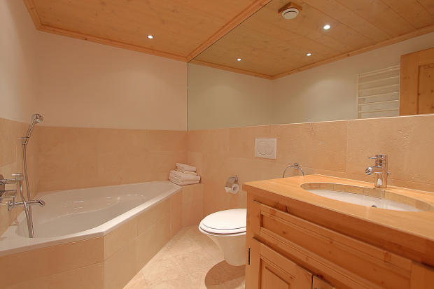 Bathroom tiled bath tub Gai Torrent Penthouse Verbier