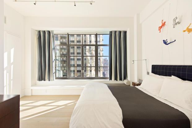 Bedroom large window wood floor Park Avenue South New York