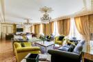Large living room parquet flooring chandelier cornicing Etoile Marceau Paris
