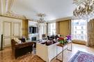 Living room parquet flooring chandelier fireplace cornicing Etoile Marceau Paris