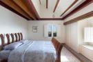 Bedroom exposed beams Villa Paula Zona Alta Barcelona