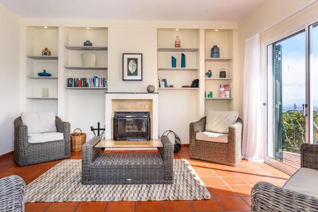 Living room tiled floor sliding doors fireplace Villa Aquarela Madeira Portugal