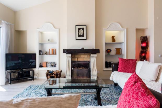 Living room fireplace wood floor Villa Aquarela Madeira Portugal