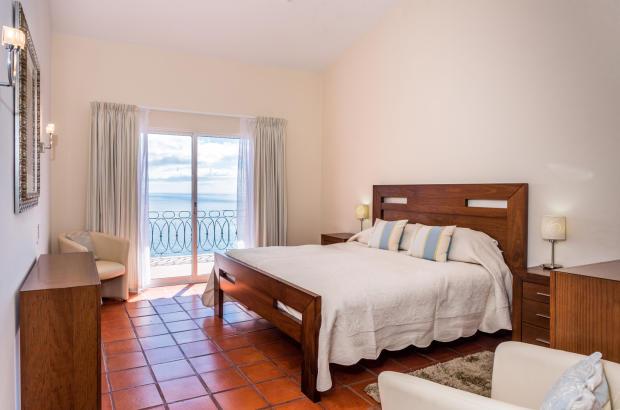 Bedroom balcony doors tiled floor Villa Aquarela Madeira Portugal