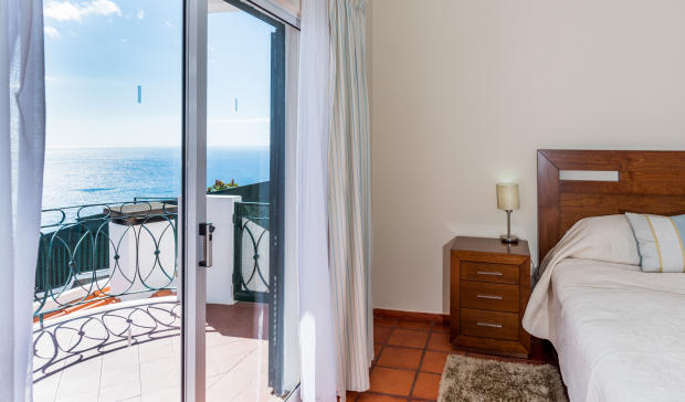Bedroom balcony sliding doors tiled floor ocean sea view Villa Aquarela Madeira Portugal