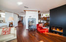 Living room kitchen fireplace wood floor Villa Olivia Lloret de Mar Girona