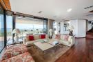 Living room sliding doors wood floor full height windows Villa Olivia Lloret de Mar Girona