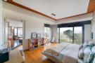 Bedroom ensuite bathroom sliding doors patio wood floor Villa Olivia Lloret de Mar Girona