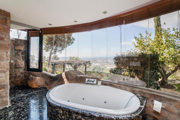 Bathroom stone bath tub large windows Villa Olivia Lloret de Mar Girona