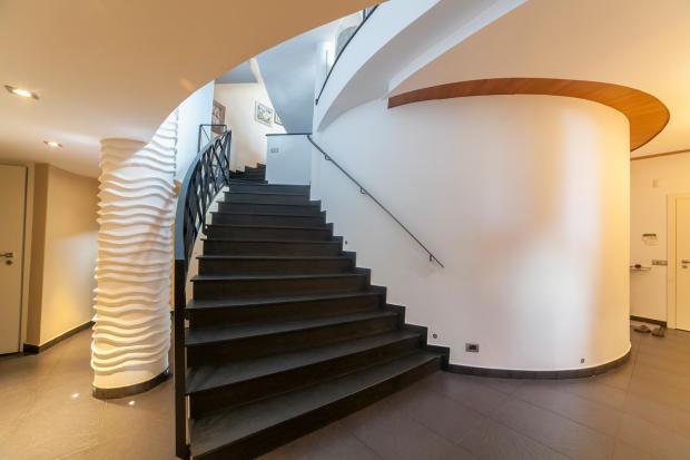 Hallway stairs stone modern column Villa Olivia Lloret de Mar Girona