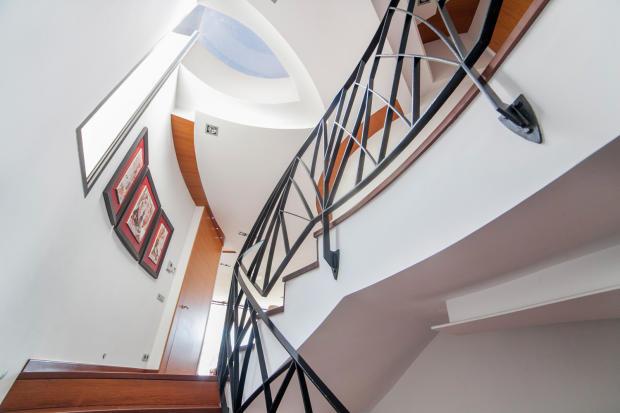Hallway stairs wood railings sky light Villa Olivia Lloret de Mar Girona