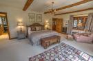 Bedroom master ensuite bathroom exposed wood beams Cascabel Ranch Colorado