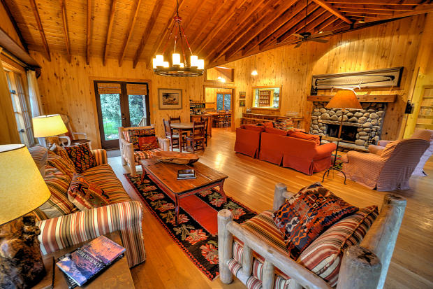 Living room fireplace wood floor Cascabel Ranch Colorado