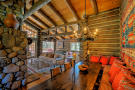 Living room full height ceiling wood floor dining Cascabel Ranch Colorado